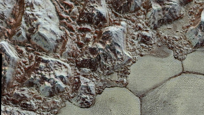 Now in super high-res color! NASA shows off enhanced zoom-in pics of Pluto