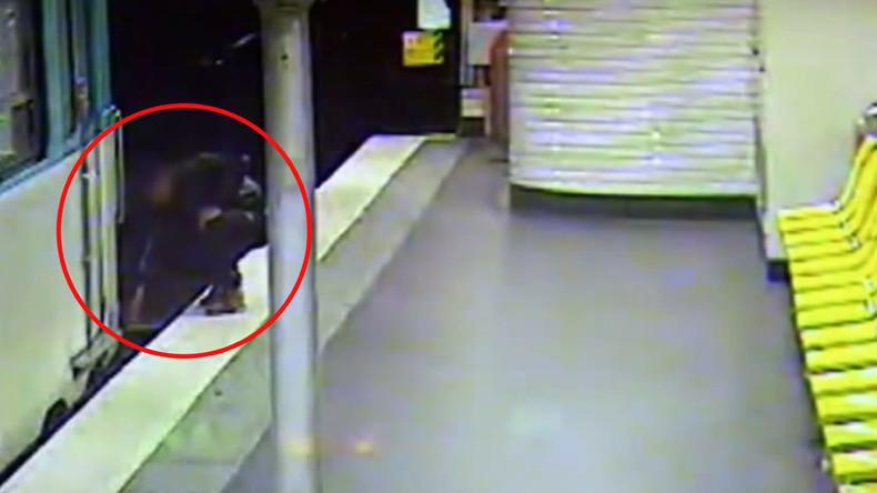 Pickpocket... Hero: Thief saves sleepwalker from metro tracks after robbing him (VIDEO)