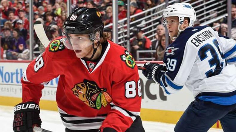 Blackhawks' Kane sizzles on ice to keep record point streak alive