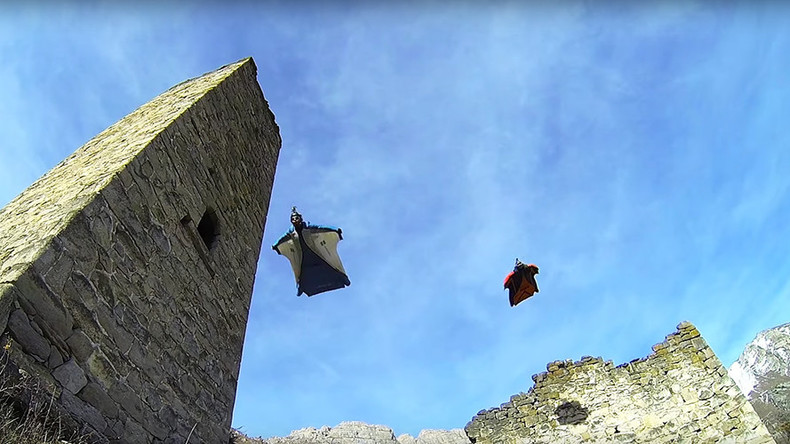 Thrilling base jump over Russia's ancient Ingush towers (VIDEO)