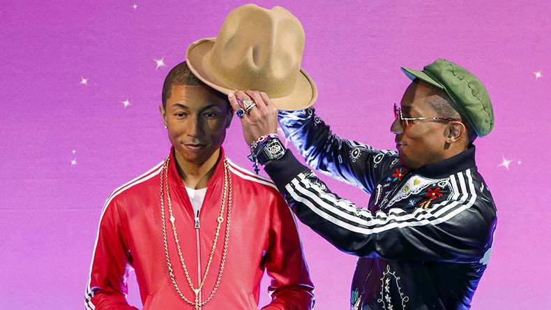 Armored truck guard rocks Pharrell-style hat