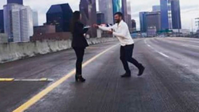 Romantic proposes on America's busiest freeway, now faces charges