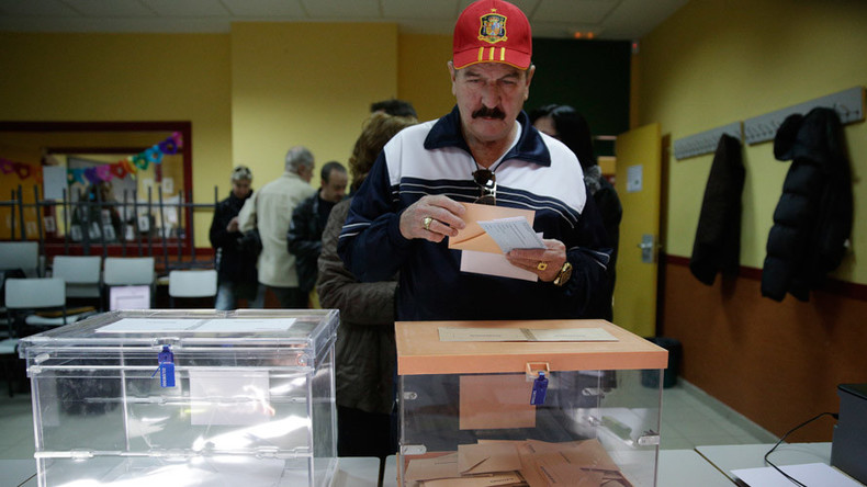 Spain's conservatives face tough challenge from fresh anti-austerity parties as Spaniards vote