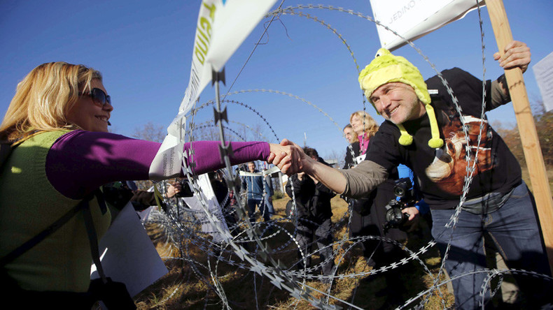 Bump, set, spiked fence: Protesters play volleyball over Slovenia's anti-refugee barrier