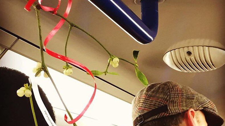 London's blushing! Mistletoe on Tube network causes awkward commute