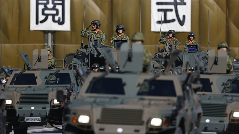 Japan cabinet approves record military budget aiming at tighter spying co-op with US
