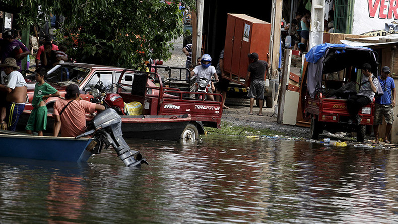 Flooding 'worst in 15 years' forces over 160,000 flee in Latin America (VIDEOS, PHOTOS)