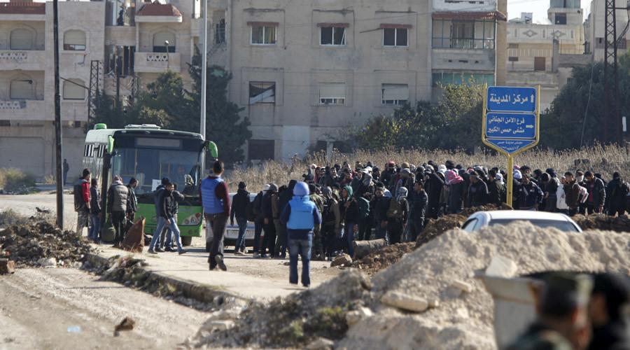 Syrian rebels leaving Homs under truce deal