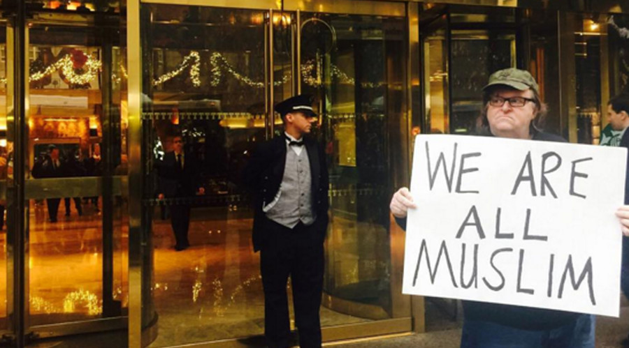 Michael Moore admits he's a 'Muslim' outside Trump Tower