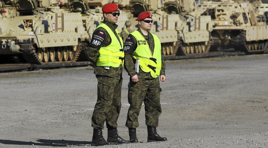 Poland sends troops to enforce 'dismissal' of NATO intel center head