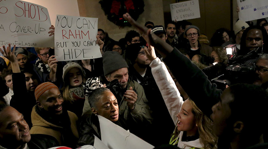 Anti-violence protesters march through streets of Chicago on New Year Eve