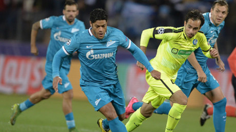 Zenit's Hulk and Gent's Rafinha, right, during a group stage match of the UEFA Champions League between Zenit (St. Petersburg) and K.A.A. Gent (Gent).© Alexei Danichev
