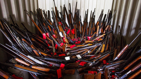 Stacks of guns are seen in a shipping container belonging to Brent Nicholson in Pageland, South Carolina, November 10, 2015. © Jason Miczek