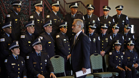 Mayor of Chicago Rahm Emanuel walks past a group of Chicago Police Department's newest recruits prior to their graduation ceremony in Chicago, Illinois © Jim Young