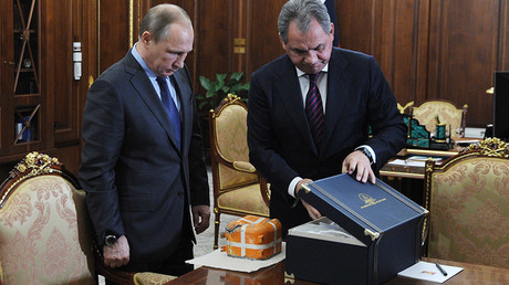 Russian President Vladimir Putin and Defense Minister Sergei Shoigu meet in the Novo-Ogaryovo residence. The parametric recorder of the Russian SU-24 combat aircraft downed by the Turkish Air Force was found and shown to the Russian President by the Defense Minister. © Michael Klimentyev