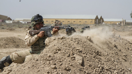 Iraqi soldiers train with members of the U.S. Army 3rd Brigade Combat Team, 82nd Airborne Division, at Camp Taji, Iraq. © Sgt. Cody Quinn