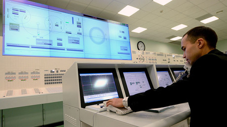 A staff member at the Beloyarsk Power Plant in the command room of the plant's fourth power unit on the day it was launched. This new unit features a BN-800 reactor. ©Pavel Lisitsyn