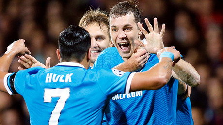 Zenit St. Petersburg's Artem Dzyuba (R) and Hulk (L) celebrate after scoring against Olympique Lyon during their Champions League Group H soccer match in Lyon, France © Robert Pratta