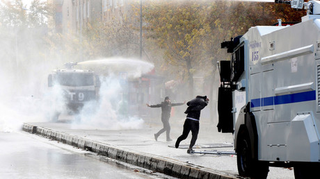 Riot police use water cannons to disperse demonstrators, Diyarbakir, Turkey. © Sertac Kayar