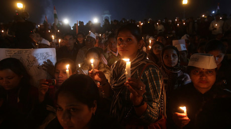 ARCHIVE PHOTO: Women participate in a candlelight vigil to show solidarity with a rape victim at India Gate in New Delhi December 21, 2012 © Adnan Abidi