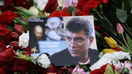 Flowers and a picture at a murder scene of politician Boris Nemtsov, who was shot dead on Moscow's Moskvoretsky bridge in the early hours of February 28, 2015. ©