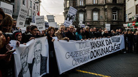Journalists and Turkish intellectuals holds a banner that reads,