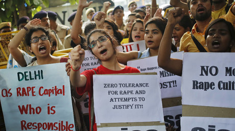 Members of All India Students Association (AISA) shout slogans as they hold placards during a protest outside police headquarters in New Delhi, India © Anindito Mukherjee
