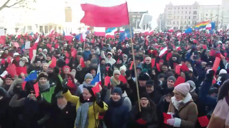 Polish protesters slap government with red card for enacting controversial laws