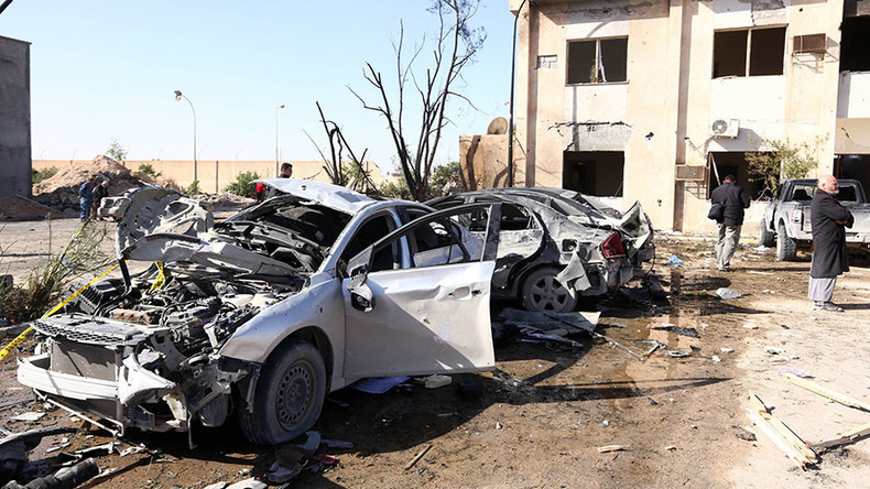 At least 65 killed in bomb attack on Libya police training center