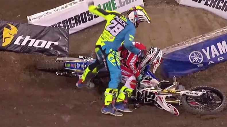 Irate motocross rider punches fellow competitor after crash (VIDEO)