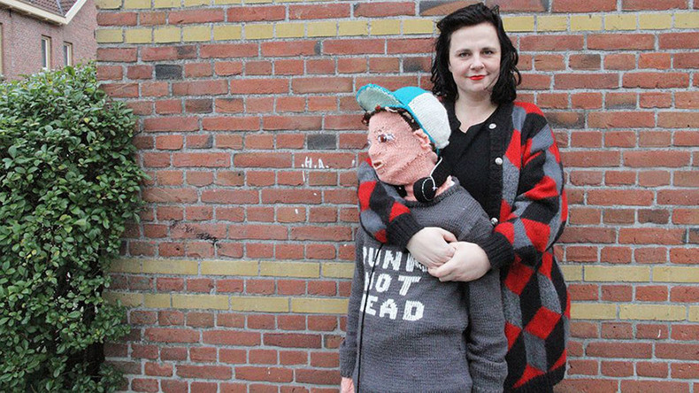 Wooly Weirdness: Mother knits life-size onesie of her own sons (PHOTOS)