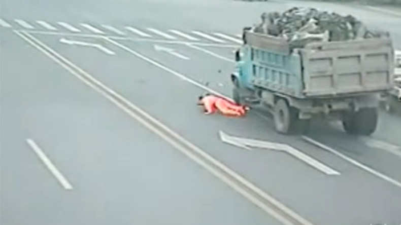 Trashed: Chinese garbage man survives head-on truck collision (VIDEO)