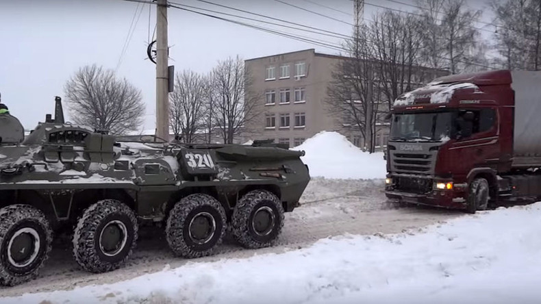 Snow job: Russian army tows 18-wheeler stuck in blizzard