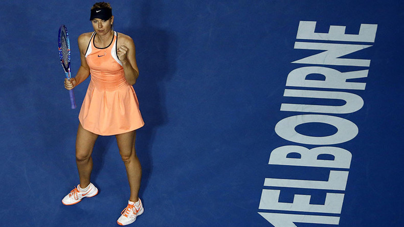 Sharapova changes dress, wins 600th career match