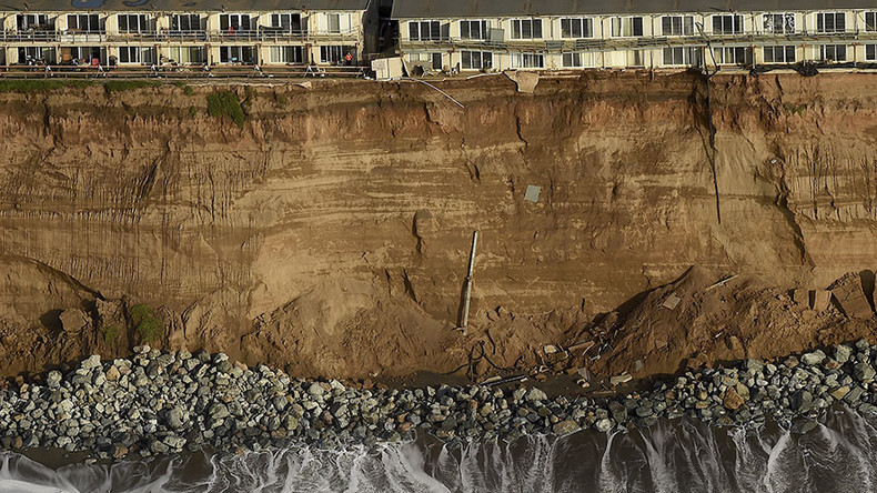 California homes on the brink, Chilean coast battered: El Nino wreaks havoc on Pacific regions