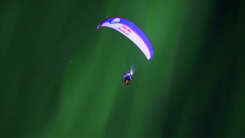Tripping the light fantastic: Spanish paraglider 'dances' with Northern Lights in Norway (VIDEO)