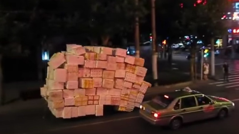 Special delivery: Motorcycle, somehow, transports dozens of boxes