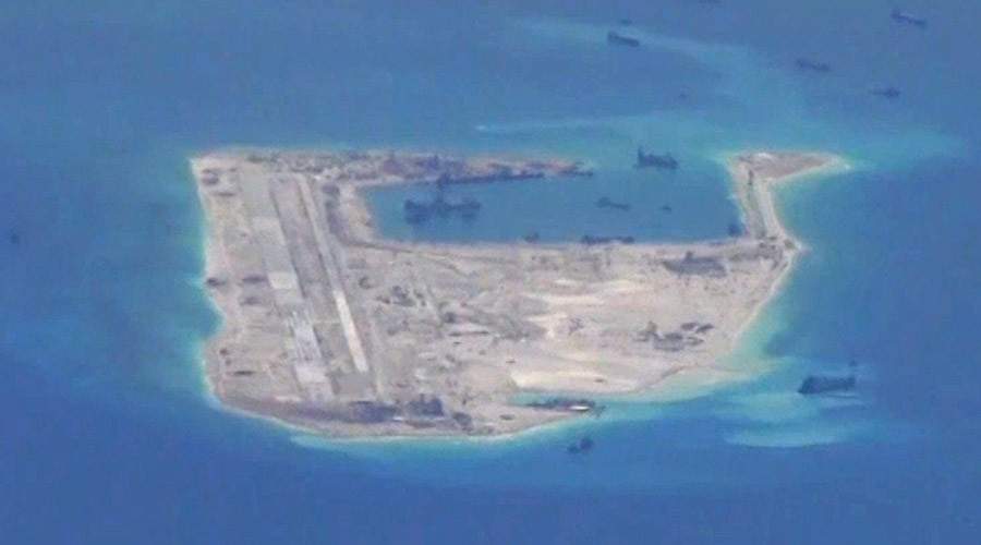 China lands 1st civilian plane on disputed islands, sparks neighbors' military fears