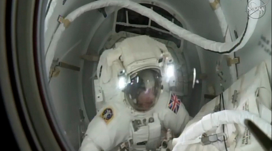 Spacewalk cut short because of water in astronaut's helmet