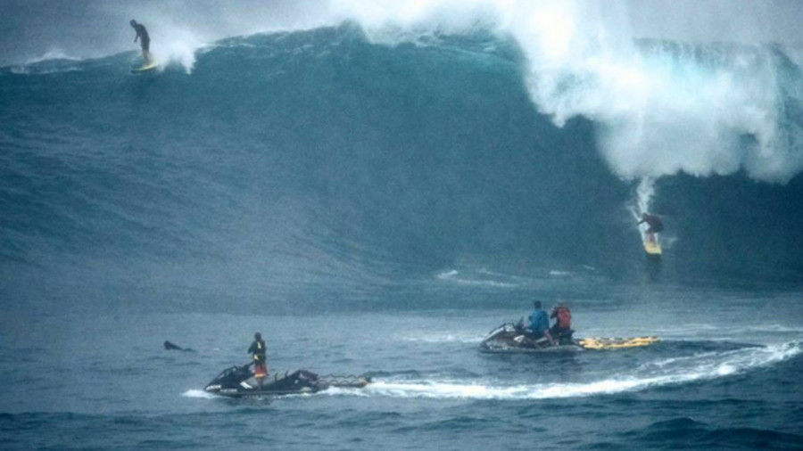 Cowabunga: Hawaii surfers ignore warnings to hit monster swells