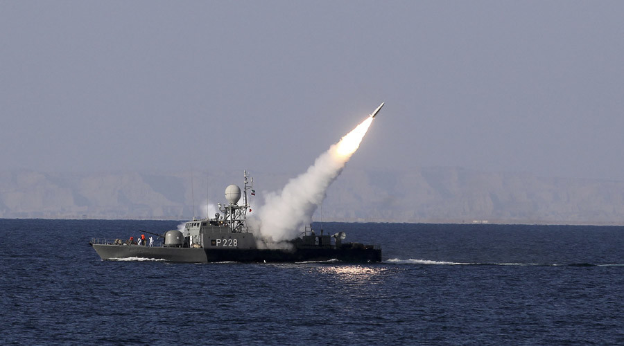 Iran holds naval drills, asks US warship to stay away