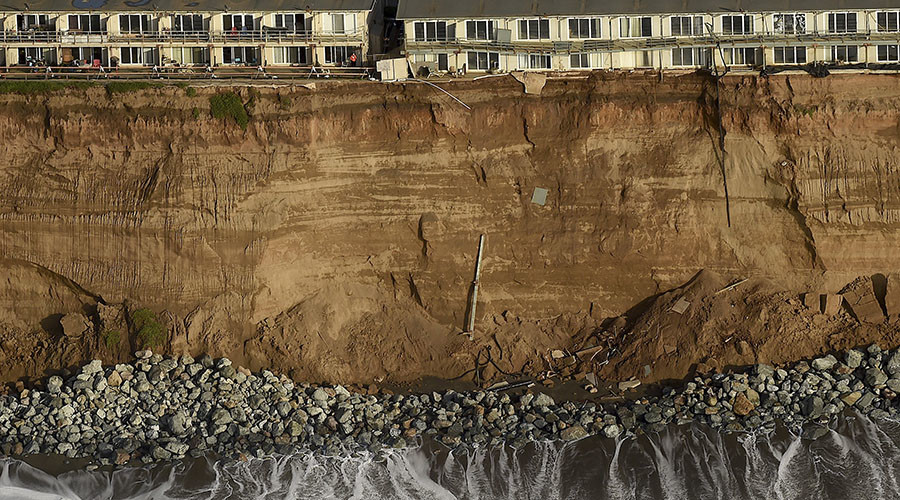 California homes on the brink, Chilean coast battered: El Nino wreaks havoc on Pacific regions