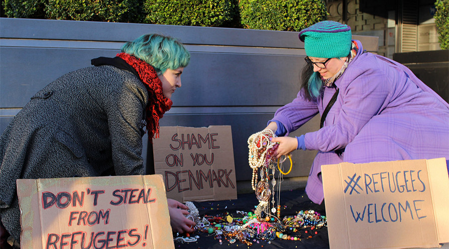 LGBT activists dump jewelry outside Danish embassy to protest seizing of refugees' valuables