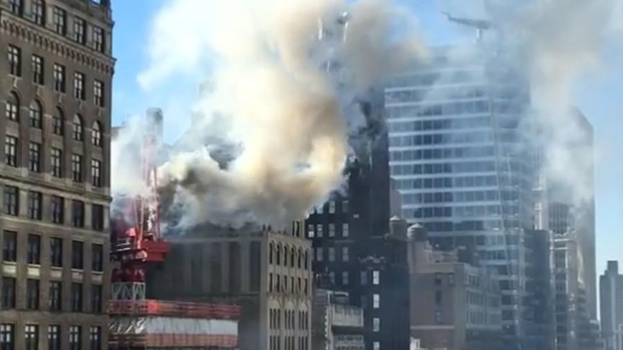 Crane catches fire in Midtown Manhattan