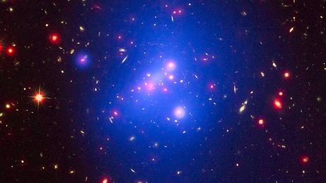 This multi-wavelength image shows this galaxy cluster, called IDCS J1426.5+3508 in X-rays from the Chandra X-ray Observatory in blue, visible light from the Hubble Space Telescope in green, and infrared light from the Spitzer Space Telescope in red © nasa.gov