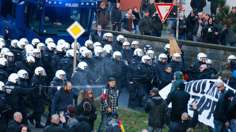 Police use pepper spray against supporters of anti-immigration right-wing movement PEGIDA (Patriotic Europeans Against the Islamisation of the West) during a demonstration march, in reaction to mass assaults on women on New Year's Eve, in Cologne, Germany, January 9, 2016. © Wolfgang Rattay