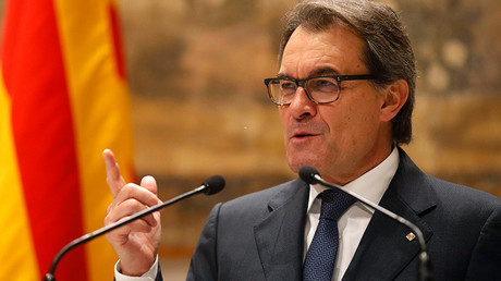 Catalonia's Mas steps down as president in deal to form new regional govt