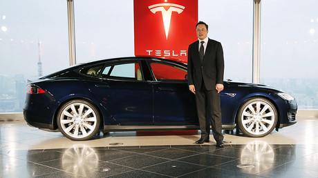 Tesla Motors Inc Chief Executive Musk poses with a Tesla Model S electric car © Toru Hanai