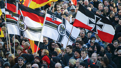Supporters of anti-immigration right-wing movement PEGIDA carry various versions of the Imperial War Flag (Reichskriegsflagge) during a demonstration march, in reaction to mass assaults on women on New Year's Eve, in Cologne, Germany January 9, 2016. © Wolfgang Rattay