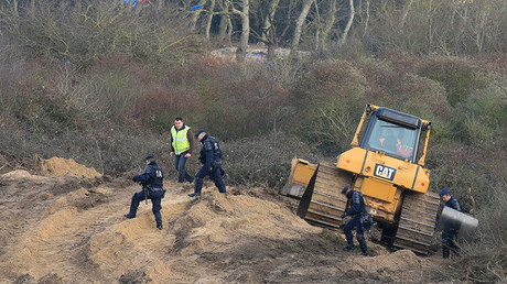 Bulldozers pull down Calais Jungle as authorities relocate migrants to container camp